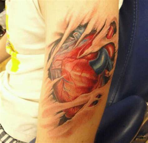 heart on sleeve tattoo design ripped on arm