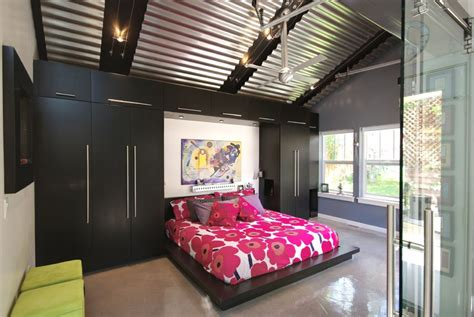 garage to bedroom high ceiling garage remodel into moden bedroom design with red flower pattern bed cover for low