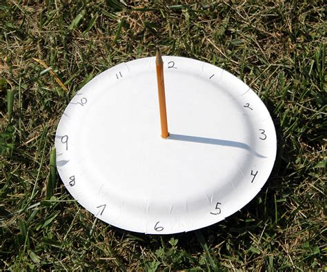 How To Make A Sundial With A Paper Plate - paper plate sundial we made that
