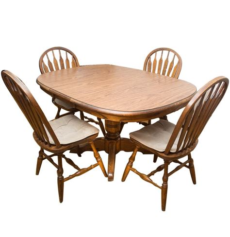 Oak Pedestal Dining Table And Chairs Walter Of Wabash Oak Pedestal Dining Table And Dinaire Style Chairs Ebth