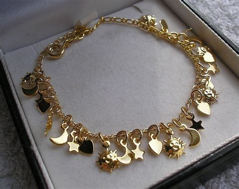 genuine sted 18ct charm bracelet 25 charms silly price