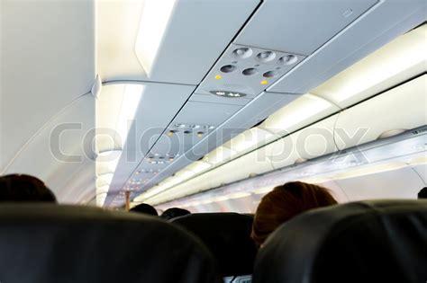 no smoking sign on plane no smoking and fasten seat belt sign on airplane stock