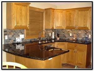 lovely White Kitchen Cabinets Black Countertops #1: oak-kitchen-cabinets-with-black-countertops.jpg