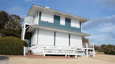 hurricane shutters in carolina coastal awnings
