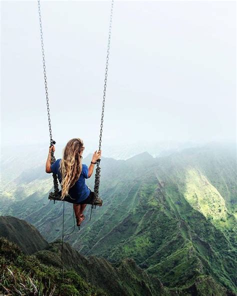 swinging hevean swing at the top of the haiku stairs in oahu hawaii usa