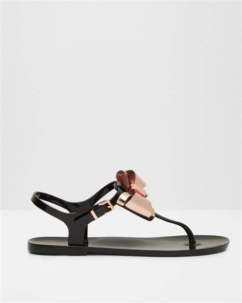 Ted Baker Jelly Sandal lyst ted baker metallic bow jelly sandals in black