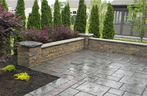 building a paver patio with retaining wall mlh design build installs award winning paver patios in central ohio landscaping outdoor