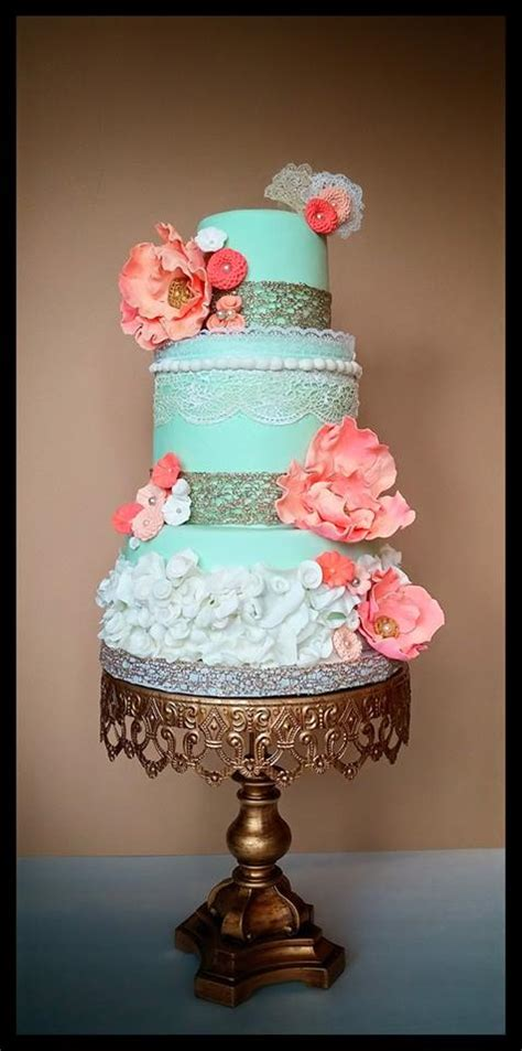 mint green coral wedding in with this mint green and coral wedding cake we