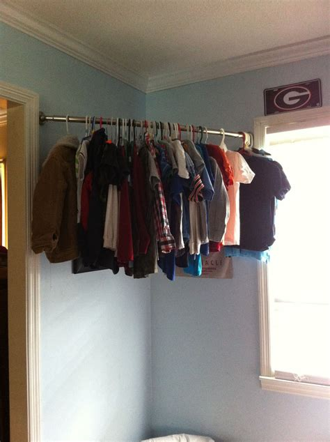 quikcloset clothes storage solution in closet rods and no closet i used a curved shower rod for my son s clothes