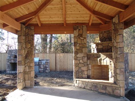 covered patio with fireplace outdoor fireplace and outdoor kitchen corner fireplace