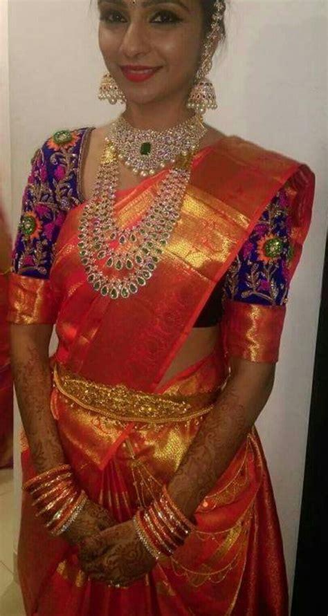 on pinterest saree blouse south indian bride and bridal sarees glamorous south indian bride in a vibrant orange