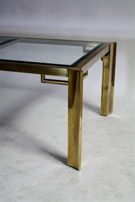 mastercraft expandable brass and glass dining table at 1stdibs