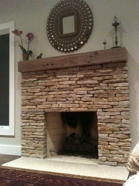 stacked stone fireplace ideas stacked stone fireplace with rustic wood mantle for living
