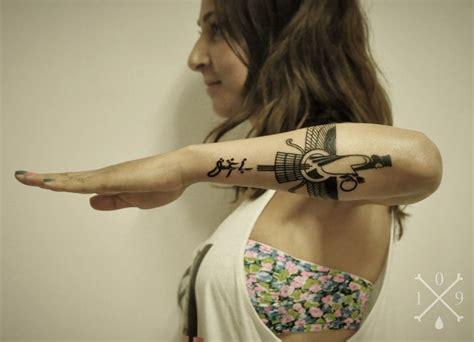 persian tattoo symbol by miss sita text by