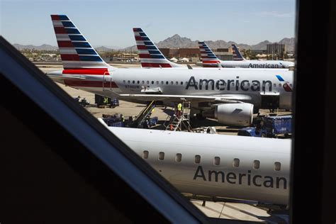american airlines relents on allowing carry on bag with discount airfare bloomberg