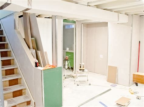 white painted ceilings and drywall in the basement the golden sycamore