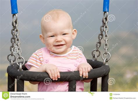 baby on swing baby girl on swing stock images image 11235464