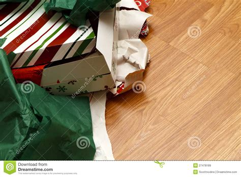 unwrapped gifts and torn wrapping paper stock