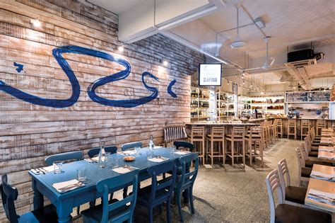 Kitchen Interior Designer Breezy Inspiration This Seafood Eatery Features A Warm