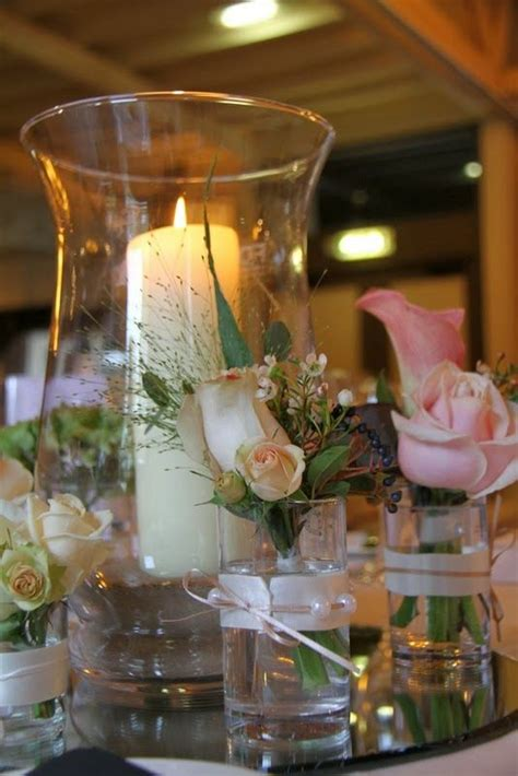Hurricane Vase Centerpiece Ideas by 1000 Images About Centre Flowers Table