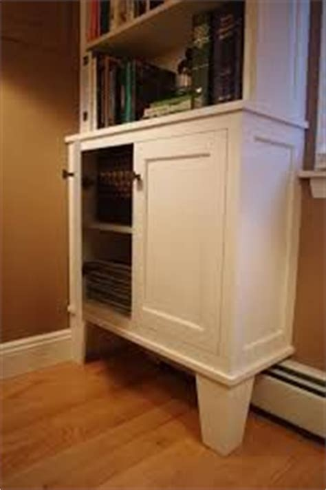 built in bookcase baseboard heat idea for putting