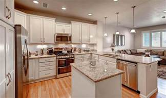 traditional kitchen with raised panel kitchen island in