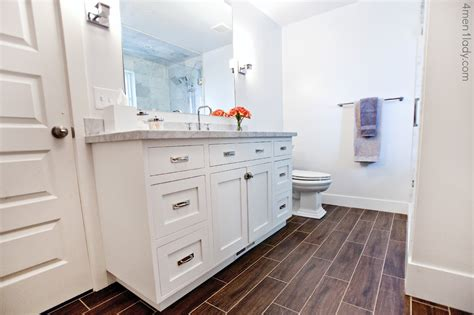 faux wood tile bathroom the granite gurus 4 men 1 lady carrara marble master