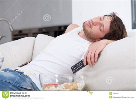 man sleeping on couch tired man sleeping on couch stock photo image 39645027