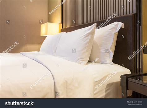 luxury bed pillows luxury bed pillow warm light stock photo 519545794