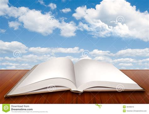 a sky of books open empty book with blank pages and blue sky stock