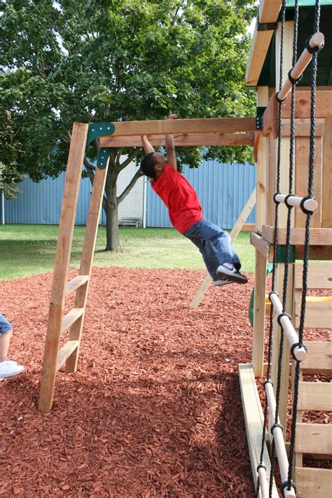 add monkey bars to swing set swing into improved coordination and upper body strength