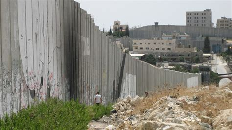 building a wall israel is building a wall to keep syrian refugees out