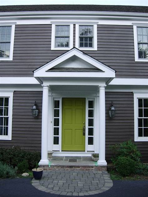 houses with dark gray siding dark grey siding and green door for the home