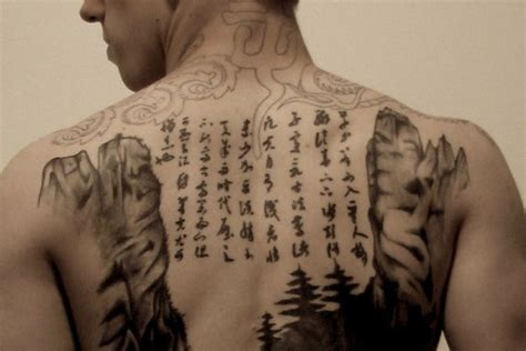 tattoo letters back japanese letters grey ink tattoo on back tattooshunt com
