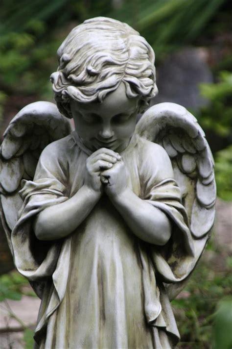 young praying angel garden figure