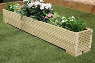 large wooden garden planter trough painted in cuprinol