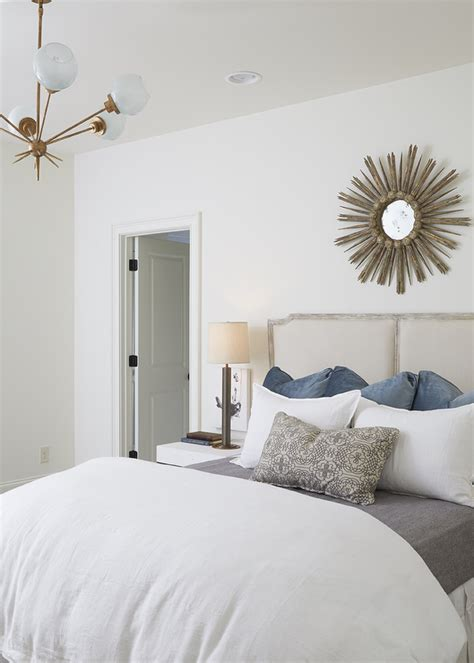 white bedroom walls french gray headboard with gold sunburst mirror transitional bedroom