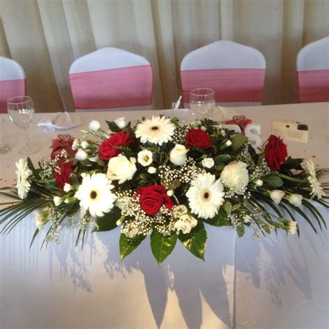 table floral arrangements top table arrangement in roses and gerbera red and white