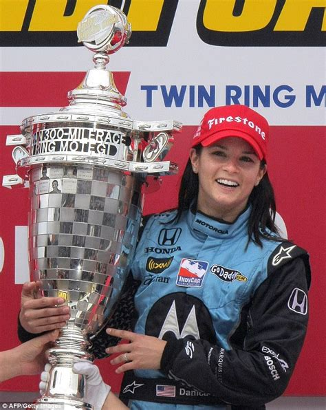 Dons Carpet by Danica Patrick Dons Skimpy Showgirl One Piece At American