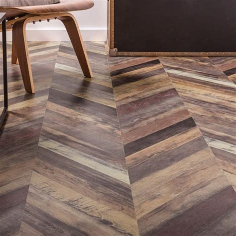 Executive Herringbone Multi Parquet Laminate 12mm 1.39m2