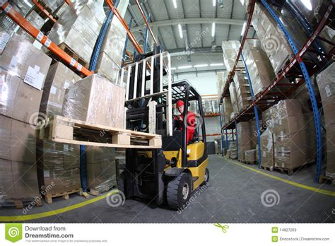Warehouse Forklift Operator by Forklift Operator At Work In Warehouse Stock Photos Image 14827263