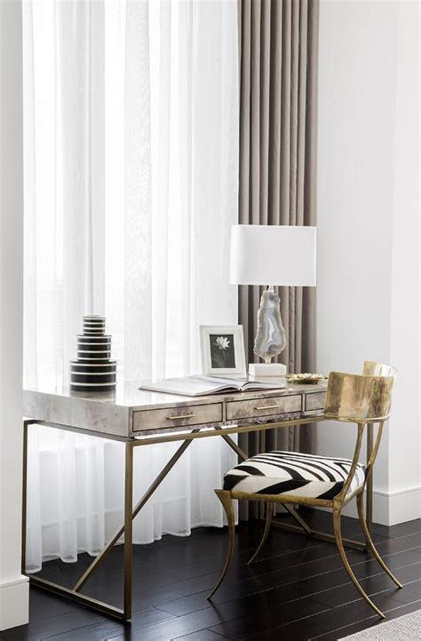 brass base desk  gray agate lamp  front  window contemporary denlibraryoffice