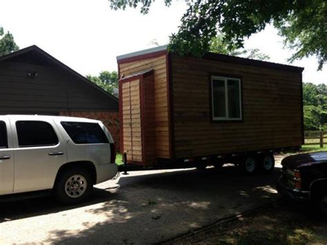 tiny house on wheels with a murphy bed