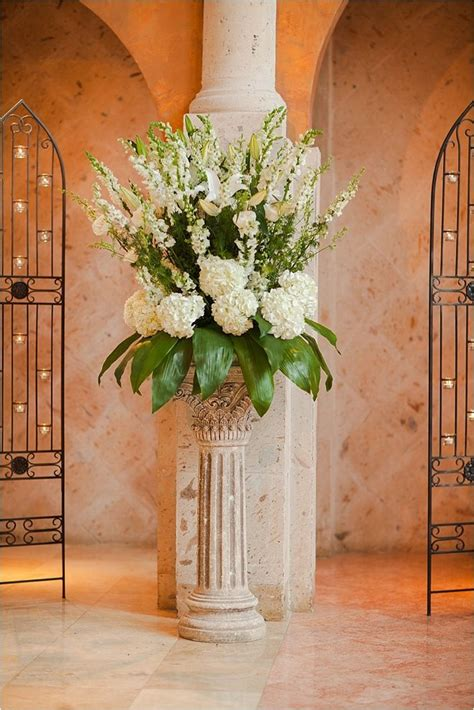ivory green flower arrangement for wedding ceremony venue the bell tower on 34th