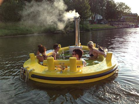 Floating Hot Tub | if it s hip it s here the hottug a motorized floating wood fired hot tub