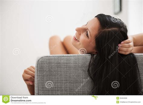 laying couch young woman with long hair laying on couch royalty free