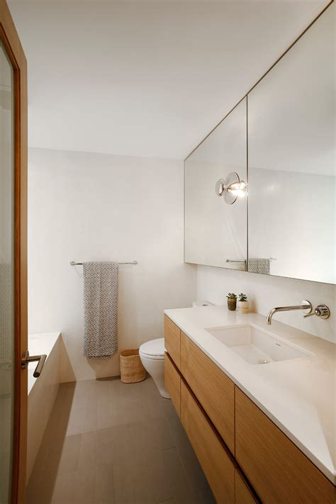 beautiful Small Full Bathroom Ideas #1: cork-flooring-for-bathroom-mirrored-bathroom-cabinet-white-countertop-vanity-wooden-drawers-towel-holder-bathtub-mini-pendant.jpg