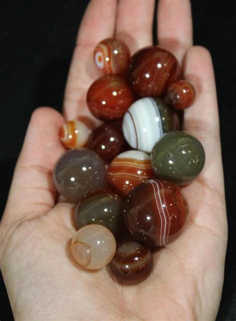Antique Handmade Marbles - 14 antique handmade carnelian agate aggie real