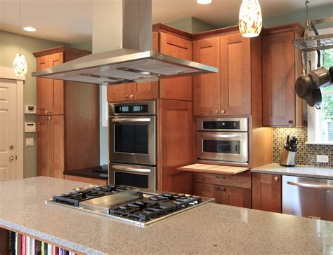 kitchen stove island island cooktop island cooktop and oven cabinets beyond