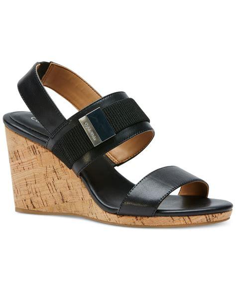 calvin klein wedge sandals calvin klein brandie wedge sandals in black lyst